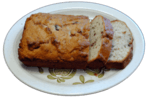 my banana bread shown on a platter with two pieces sliced ready to take