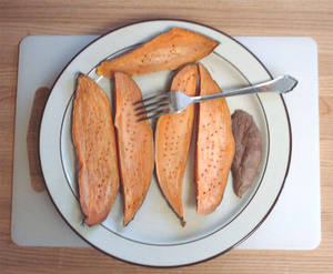 cooked yam slices pierced