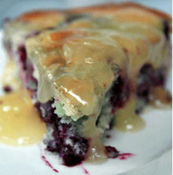 Blueberry buckle drizzled with lemon sauce used as a header image