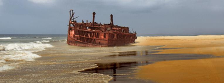 picture of a ship stuck on a sandbar ages ago, used as a header image