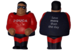 a small doll dressed in red with a black cap and DUCA on the chest used for header image