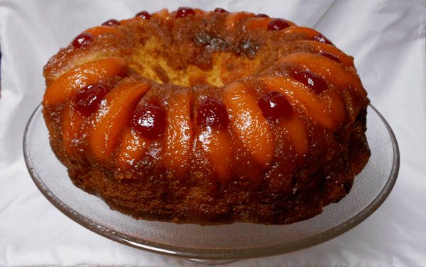 peach upside-down cake on a serving platter