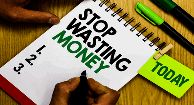 "Text on a writing pad states ""Stop Wasting Money - Today"""""