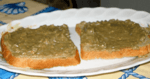 2 slices of bread with a green bread spread on them