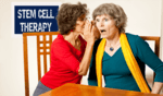 "one lady is whispering into another lady's ear, shocking her with whatever is being said. Sign behind states ""Stem Cell Therapy""."