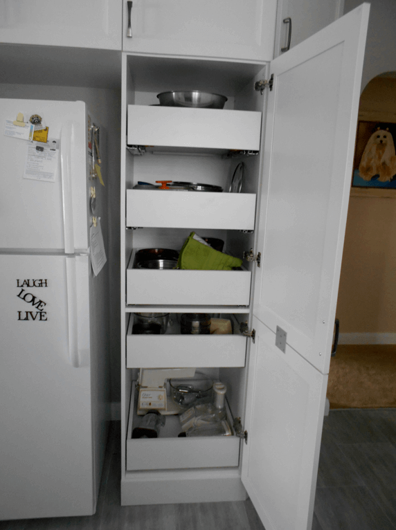 cupboard beside fridge